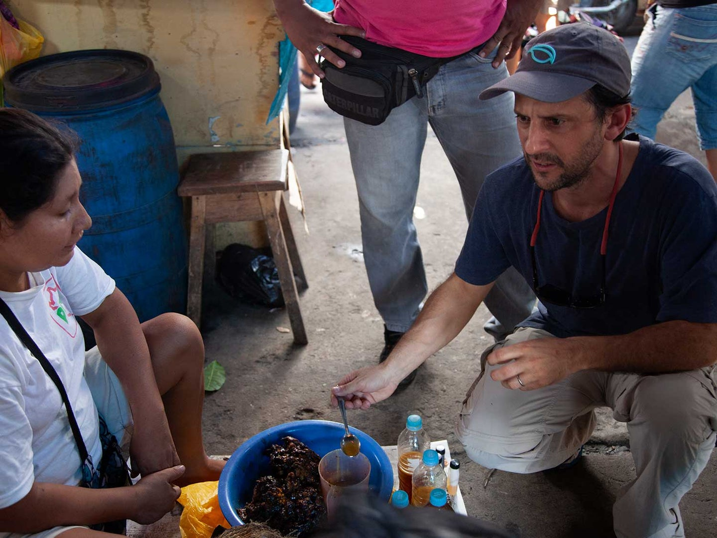 Peruvian chef Pedro Miguel Schiaffino speaks with a vendor at the Mercado de Belén in the Amazonian city of Iquitos.