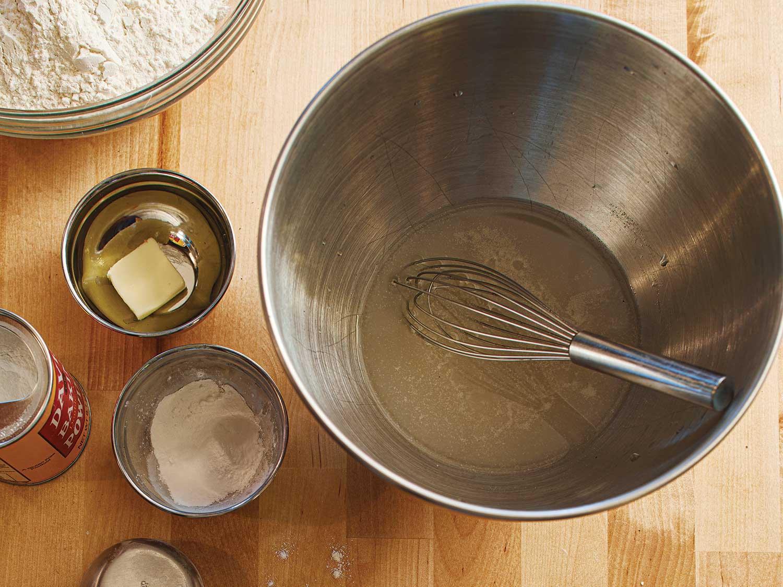 1cup plus 2 tablespoons tepid water, 1¼teaspoons sugar, and ¼ teaspoon dry instant yeast, 3¾cups plus 2tablespoons all-purpose flour, 2½teaspoons baking powder, and 1½teaspoons kosher salt.