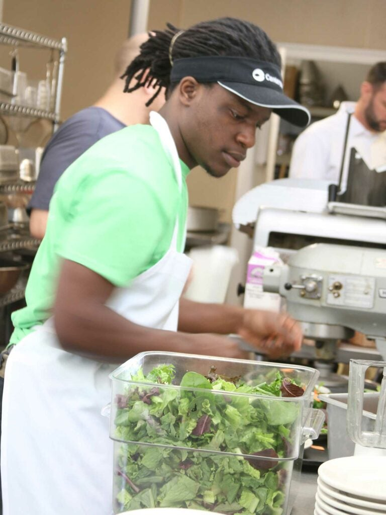 Interns prep salad greens for the cafe menus, and expand their fresh food vocabulary at the same time.