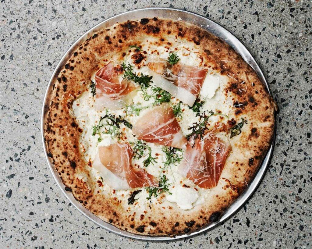 The Crudo pizza: ricotta, mozzarella, prosciutto, and mustard frills, on the menu at Pizzeria Vittoria.