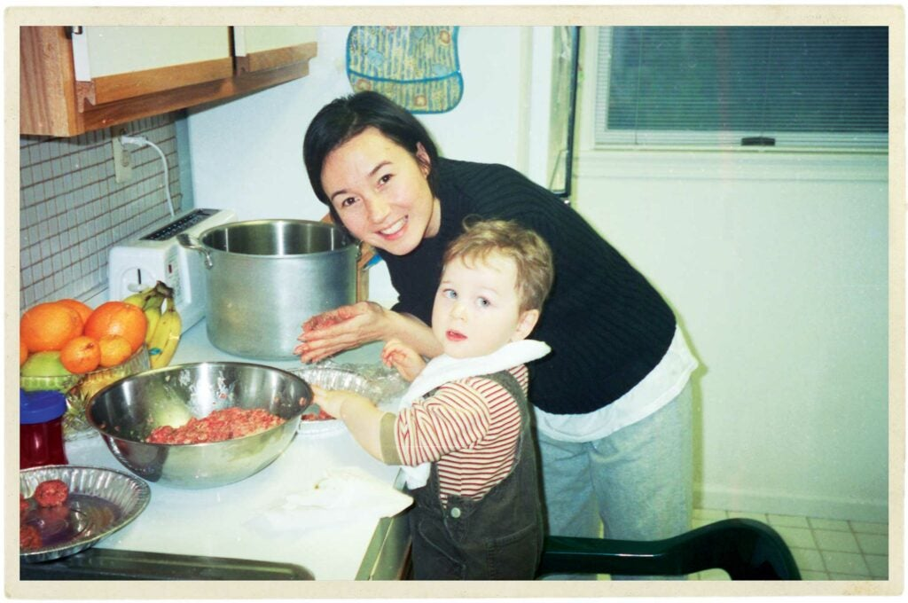 Mother and son making meatballs.