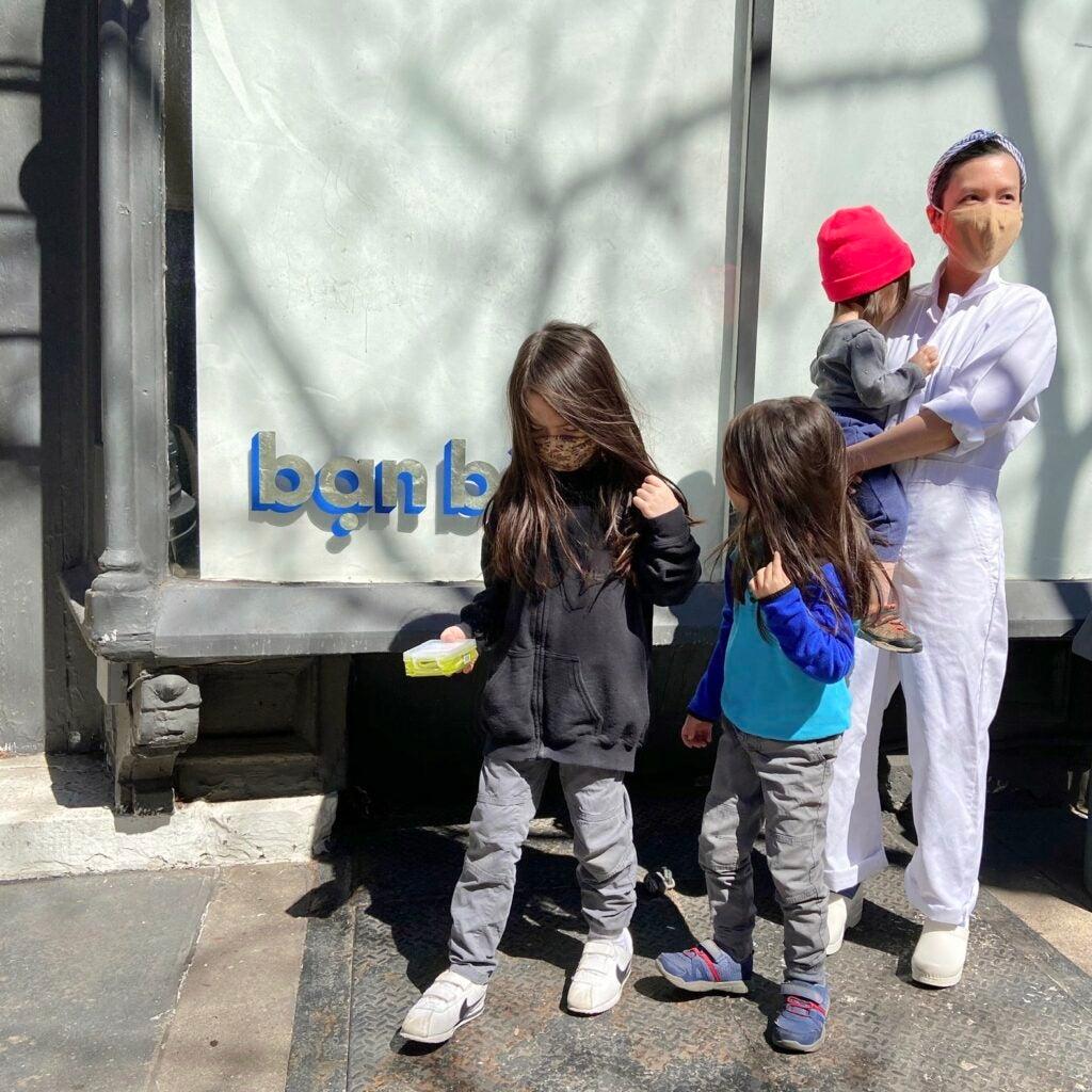 Doris Hồ-Kane outside her bakery with her children.