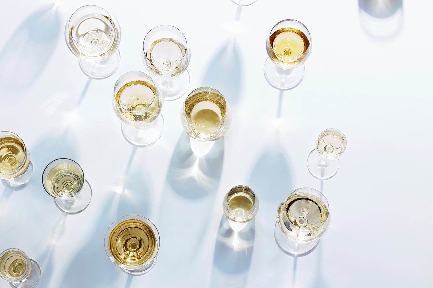 Overhead shot of white wine in glasses