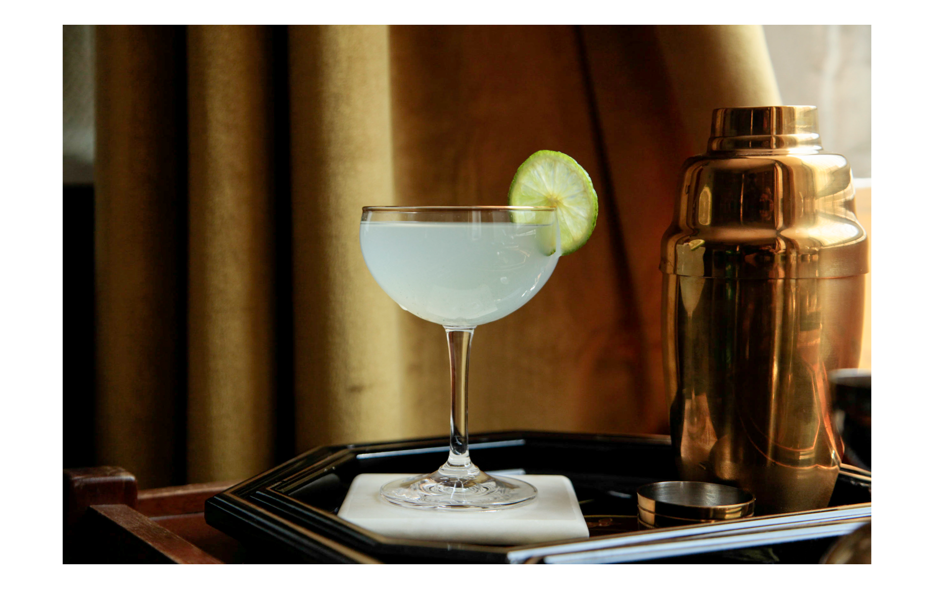 Classic Gin Gimlet with golden cocktail shaker