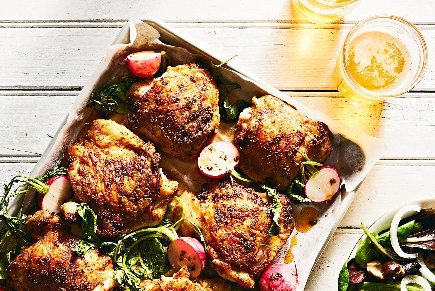 Radishes roasted on the same baking sheet as the chicken are an excellent partner for the juicy spiced meat.