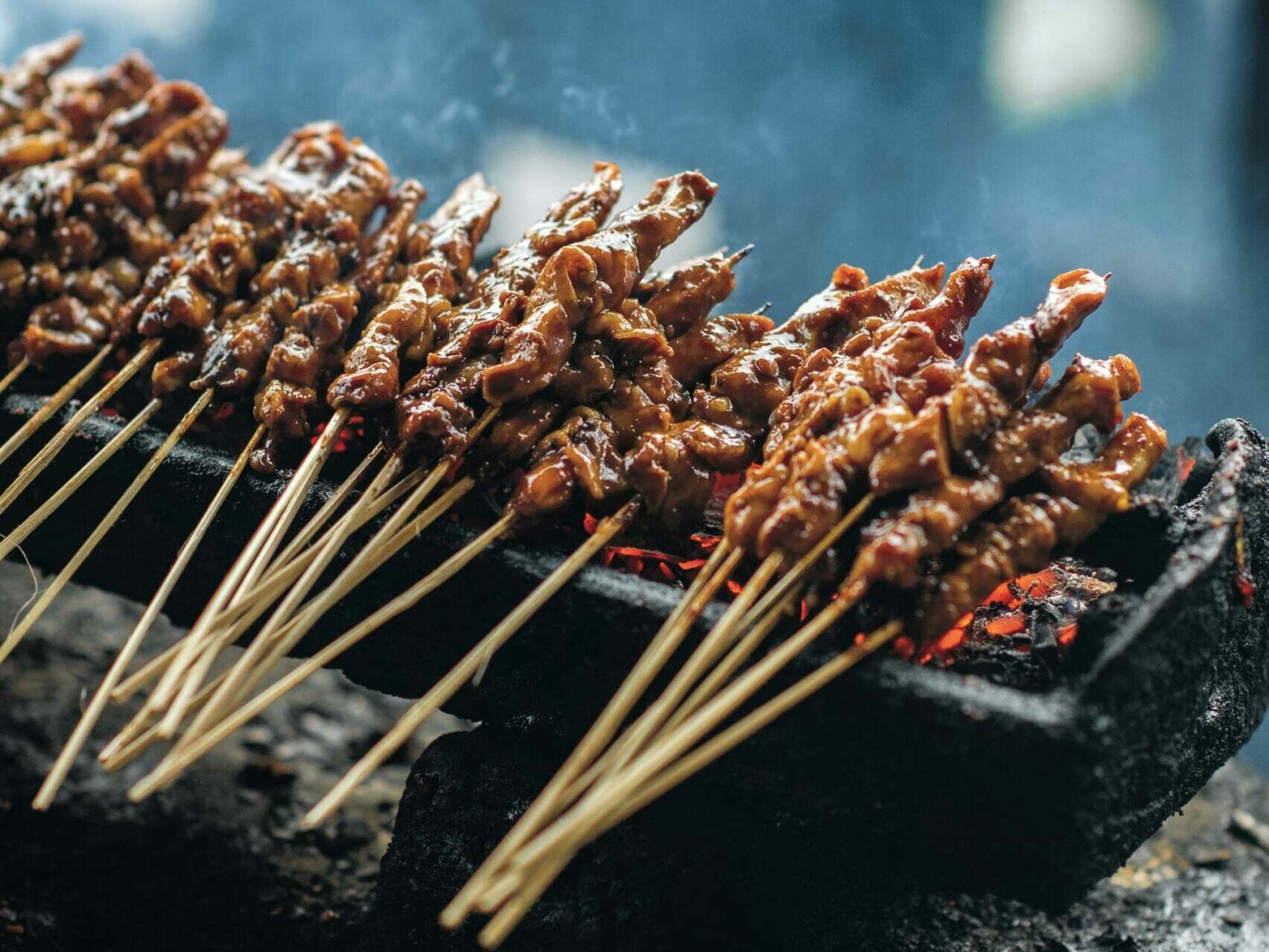 Chicken satay skewers with spicy peanut sauce (sate ayam)