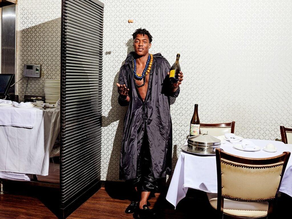 Mozel Watson Holding Bottle of Wine