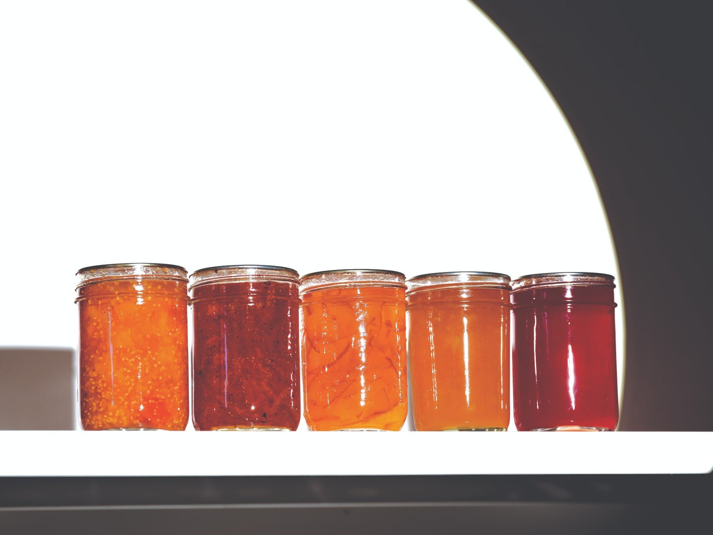 Line of Canned Jars of Jams and Jellies