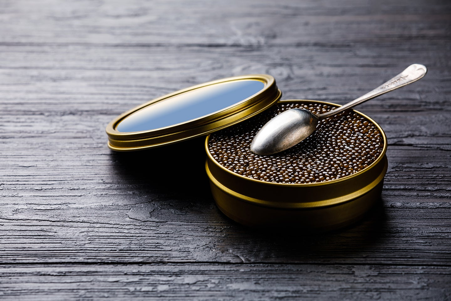 Black caviar in can and spoon
