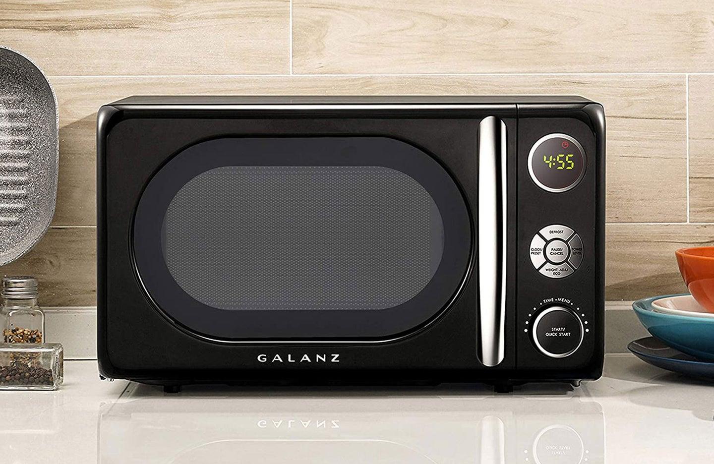 black microwave on kitchen countertop