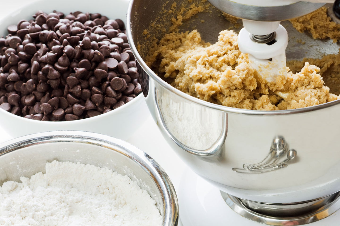bowl of cookie dough with bowl of chocolate chips